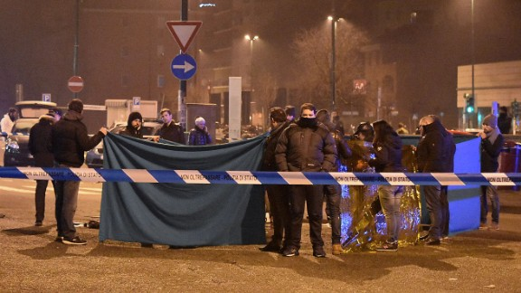 Italian authorities cordon off the area Friday where Amri was shot.