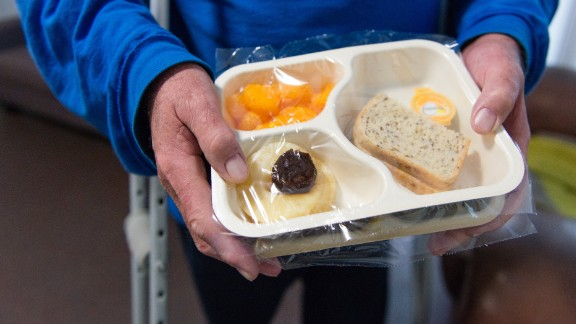 Patrick Ward from Venice, Calif., gets food delivered from Meals on Wheels every week. The 58-year-old uses crutches due to his osteoarthritis and knee problems and says his lack of mobility makes cooking difficult. (Heidi de Marco/KHN)