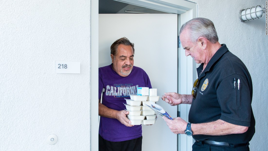 Meals on Wheels volunteer Mike Kearin delivers food to client Jesus Barron.
