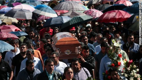 The funeral of one of the victims of the fireworks market explosion in Tultepec, Mexico state, on December 22, 2016. Work continues in Mexico to identify charred bodies left by the December 20, 2016  explosion that killed at least 33 people in the country's biggest fireworks market, in a Mexico City suburb, as authorities investigated what caused the multi-colored salvo of destruction.  / AFP / PEDRO PARDO        (Photo credit should read PEDRO PARDO/AFP/Getty Images)