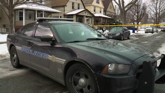 Police investigate the fatal shooting of a 2-year-old boy in Cleveland on December 23, 2016.