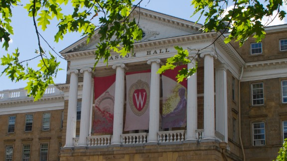 A scene on campus at the University of Wisconsin-Madison on July 10, 2014, in Madison, Wis. Bascom Hall is seen with a statue of President Abraham Lincoln in front of the building.(AP Photo/Jon Elswick)