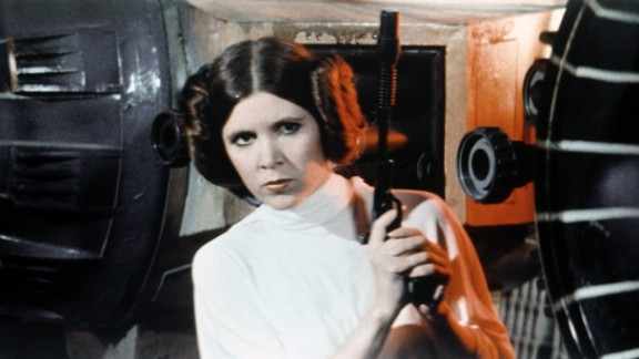Carrie Fisher is seen as Princess Leia on the set of George Lucas