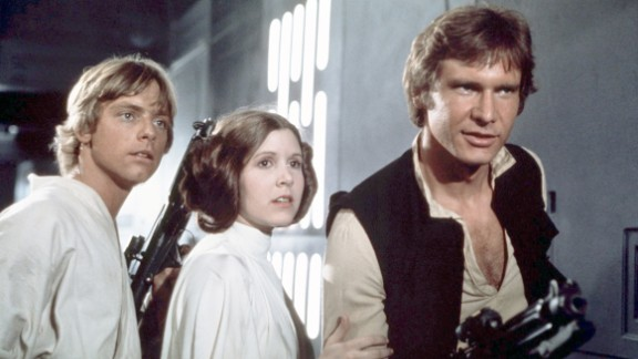 """Mark Hamill (Luke Skywalker), Fisher and Harrison Ford (Han Solo) on the set of """"Star Wars: Episode IV -- A New Hope"""" in 1977."""