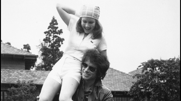 """Warren Beatty and Fisher, then 17, take a break during filming of the movie """"Shampoo"""" in 1974. Fisher has acted in films, plays and television shows, and has written a number of best-selling books."""