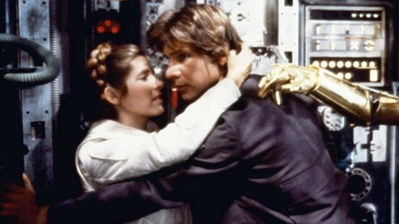 "Harrison Ford and Fisher embrace during filming of ""Star Wars: Episode V - The Empire Strikes Back"" in 1980. On November 16, 2016, Fisher revealed to People magazine that she and co-star Ford had an affair during the 1976 filming of ""Star Wars."""