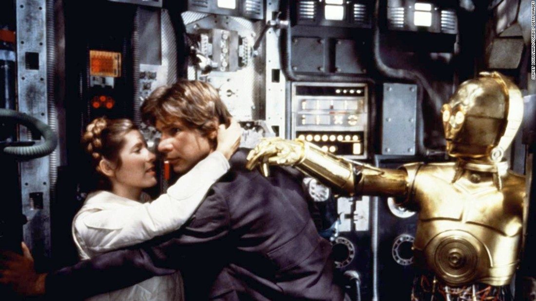 "Harrison Ford and Fisher embrace during filming of ""Star Wars: Episode V - The Empire Strikes Back"" in 1980. On November 16, 2016, Fisher <a href=""http://www.cnn.com/2016/11/16/entertainment/carrie-fisher-harrison-ford/index.html"" target=""_blank"">revealed to People magazine that she and co-star Ford had an affair</a> during the 1976 filming of ""Star Wars."""