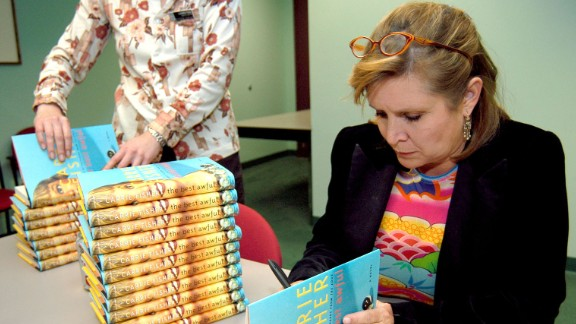 """Fisher attends a book signing for her novel, """"The Best Awful,"""" in Beverly Hills, California, in 2004. The semi-autobiographical novel fictionalized events from Fisher"""
