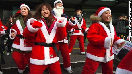 Protesters dressed as Santa urge the removal of impeached President Park Geun-hye on Saturday.