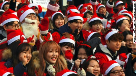 South Koreans don holiday attire at Saturday's rally in the ninth straight weekend of protests.