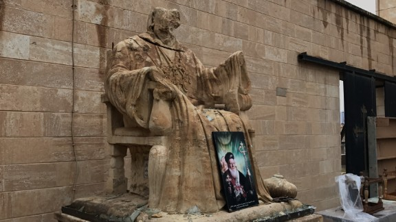 A religious statue vandalized by ISIS stands outside Mart Shmony Church in Bartella.