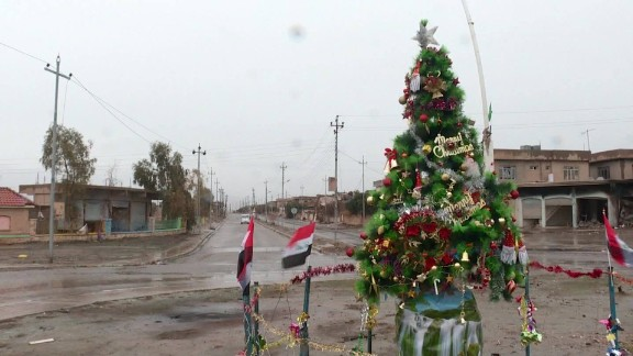 A plastic tree outside the Mart Shmony Church marks the return of Christmas to battle-scarred Bartella.