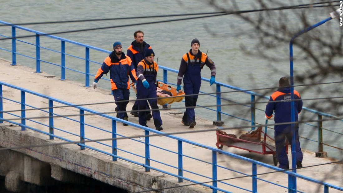 Russian emergency workers carry remains from the wreckage of the Tu-154 plane that crashed near Sochi on December 25.