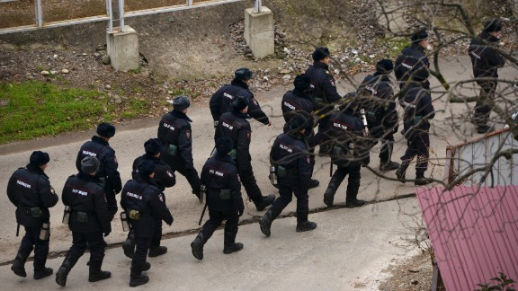 Russian police secure the area near where the plane crashed. In addition to the ensemble, the plane was carrying eight crew, eight soldiers and nine journalists.