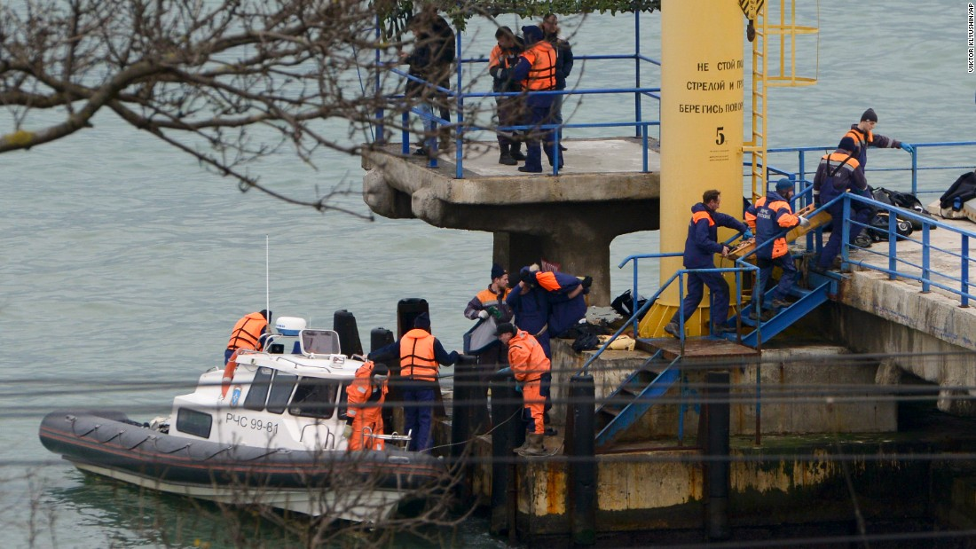 Russian emergency personnel work near the site of the crash on December 25. The plane was en route from Moscow to Syria and had stopped in Sochi to refuel.