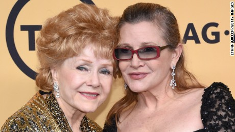 Debbie Reynolds and Carrie Fisher at the 21st Annual Screen Actors Guild Awards on January 25, 2015.  (Photo by Ethan Miller/Getty Images)