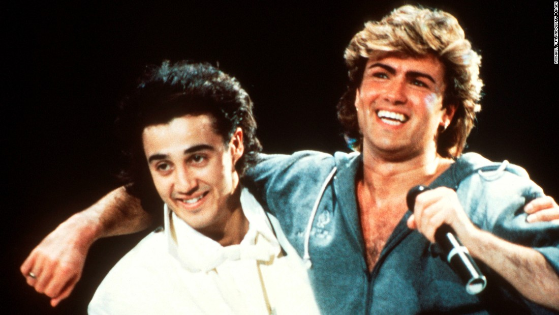 Andrew Ridgeley and George Michael of Wham! perform on stage in 1985. The duo met at Bushey Meads School, in 1976, according to Michael's website.