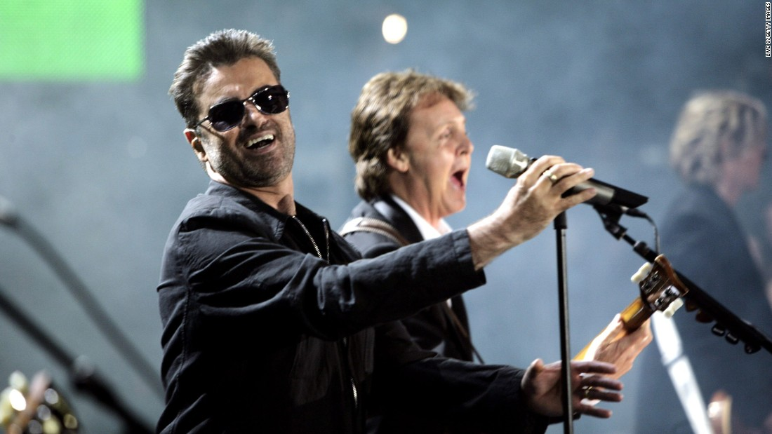 "George Michael, left, and Paul McCartney perform together at the ""Live 8 London"" concert on July 2, 2005 in London."