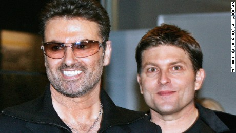 The late British pop star George Michael (left) with his then-partner Kenny Goss in 2005.