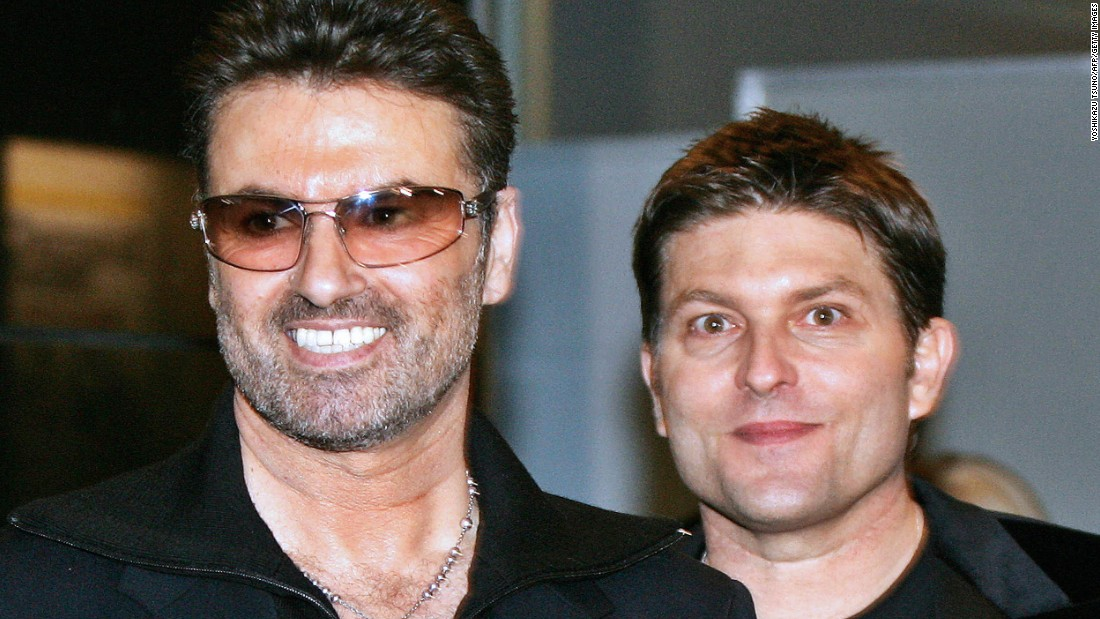 "George Michael, left, with his partner Kenny Goss at a reception after the Japan premiere of his autobiographical movie ""George Michael: A Different Story,"" in December 2005. In 1998, Michael told CNN in an exclusive interview that he was gay."