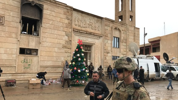 US and Iraqi security forces were on hand to protect churchgoers after ISIS reportedly made threats to attack Bartella.