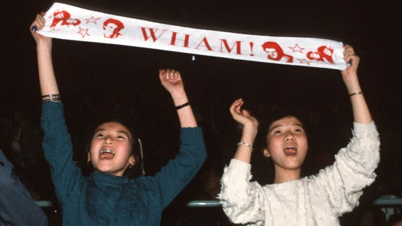 Fans of Wham! enjoy the concert in Beijing.