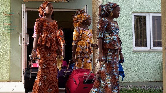 The girls leave accommodations in Abuja on Friday en route to the airport to begin the six-hour journey home to Chibok after being held captive by Boko Haram militants for nearly three years.