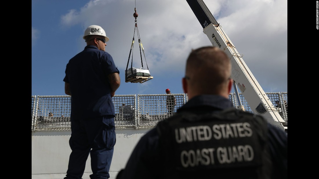 The crew of the US Coast Guard ship Hamilton use a crane to offload approximately 26.5 tons of cocaine in Fort Lauderdale, Florida, on Thursday, December 15. The drugs, worth an estimated $715 million, were from 27 separate suspected drug smuggling vessels and 5 bale recovery operations by the US Coast Guard, Royal Canadian Navy and its interagency partners.
