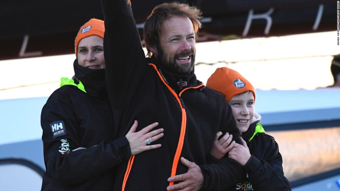 Coville spent Sunday night on board alone after completing the feat, but was joined for his arrival in the port by wife Cathy (L) and son Eliott (R).