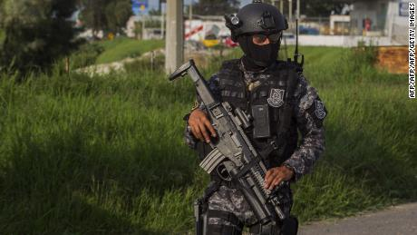 State Police elite group personnel patrol a street during a security operation in Jamay, Jalisco State Mexico, on September 30, 2016. Three more corpses were found on the banks of the Lerma River, near Lake Chapala raising the count to 13 bodies. / AFP / Hector-Guerrero        (Photo credit should read HECTOR-GUERRERO/AFP/Getty Images)