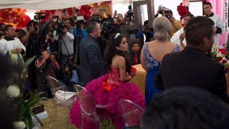 e556dbab67e Rubi Ibarra makes her way through the crowd to her birthday Mass at her  Quinceanera party