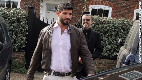 George Michael (right) and Fadi Fawaz outside their London home in 2012.