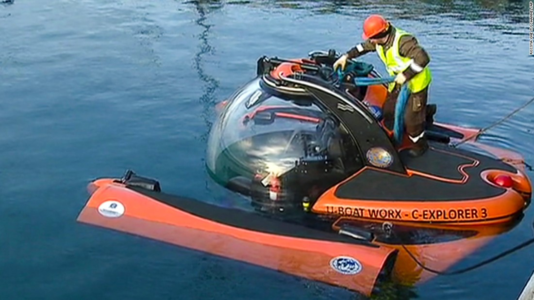 Emergency Ministry personnel prepare a submersible craft Tuesday to search for sunken wreckage and victims' remains. Thirteen bodies had been recovered from the Black Sea as of Tuesday morning.