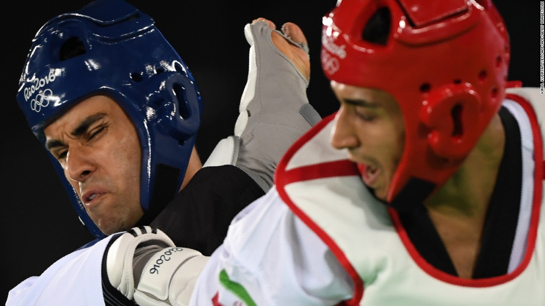 It was his first appearance at the Olympics, having failed to qualify on two previous occasions. Taufatofua lost his preliminary bout against Iran's Sajjad Mardani (R) in the +80 kg category.