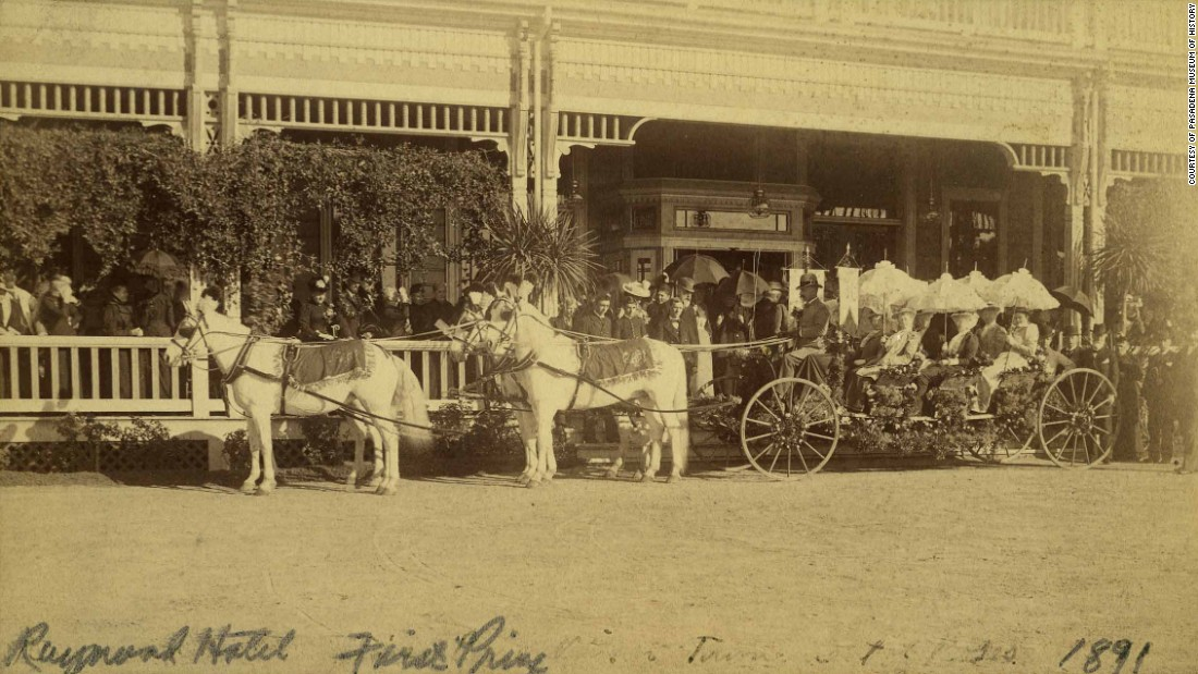 The carriage that won first prize in 1891 stands outside the Raymond Hotel. Pasadena, California, has always been the home of the Rose Parade and the Rose Bowl Game.