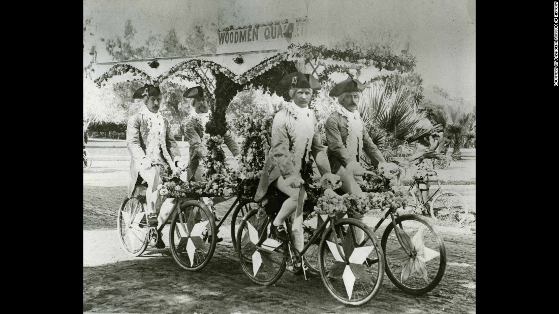 A group of men known as the Woodmen Quartet ride their bicycles together in the 1893 parade.