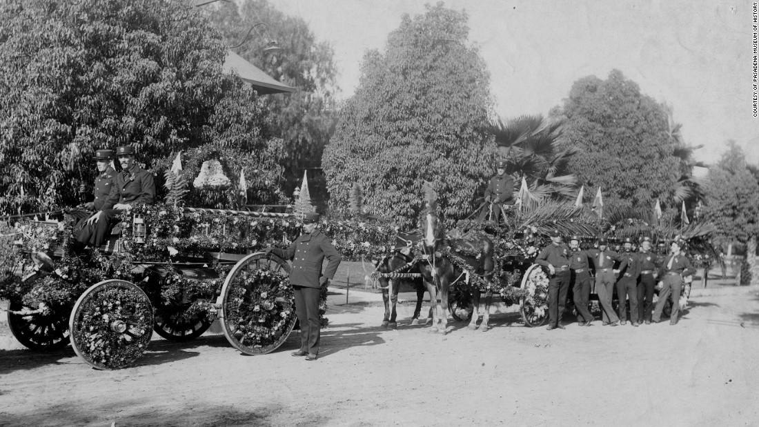Firefighters pose with their department's entry in the 1896 parade.