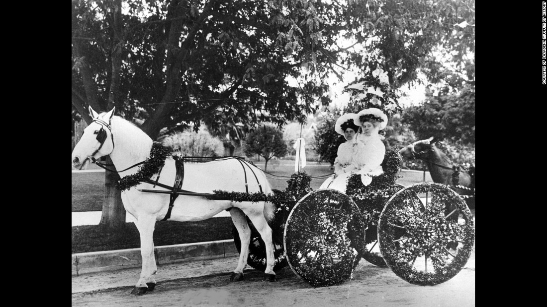 Women sit in their carriage in 1899.