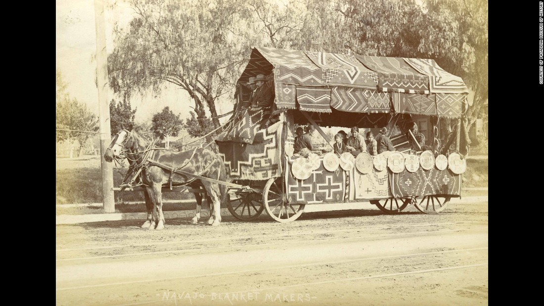 "A photograph marked as ""Navajo Blanket Makers"" shows Native Americans riding aboard a wagon at the 1903 parade."
