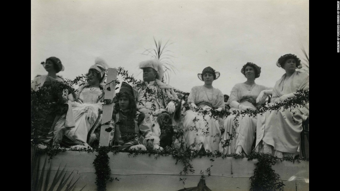 The king and queen, Dr. Fitch C. E. Mattison, fourth from left, and Miss Mabel Seibert, third from left, ride with the other members of the Rose Court in 1914.