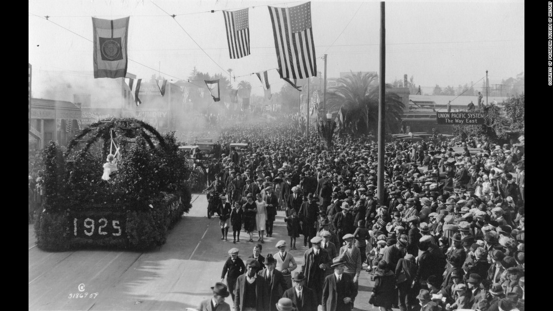 A mass of spectators are seen along the parade route in 1925.