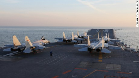 This picture taken on an undisclosed date in December 2016 shows Chinese J-15 fighter jets waiting on the deck of the Liaoning aircraft carrier during military drills in the Bohai Sea, off China's northeast coast.