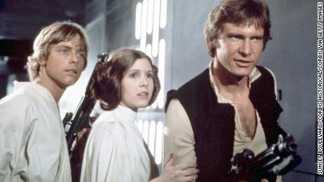 American actors Mark Hamill, Carrie Fisher and Harrison Ford on the set of Star Wars: Episode IV - A New Hope written, directed and produced by Georges Lucas. (Photo by Sunset Boulevard/Corbis via Getty Images)