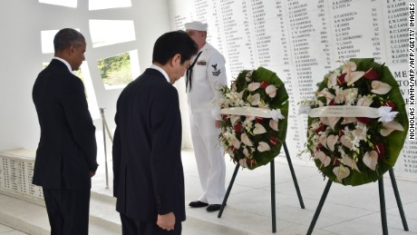 "US President Barack Obama(L) and Japanese Prime Minister Shinzo Abe place wreaths at the USS Arizona Memorial December 27, 2016 at Pearl Harbor in Honolulu, Hawaii.  Abe and Obama made a joint pilgrimage to the site of the Pearl Harbor attack on Tuesday to celebrate ""the power of reconciliation. ""The Japanese attack on an unsuspecting US fleet moored at Pearl Harbor turned the Pacific into a cauldron of conflict -- more than 2,400 were killed and a reluctant America was drawn into World War II. / AFP / Nicholas Kamm        (Photo credit should read NICHOLAS KAMM/AFP/Getty Images)"