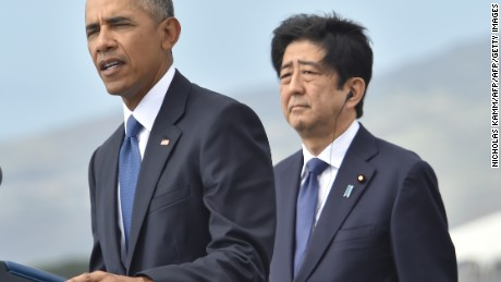 "US President Barack Obama (L) speaks as Japanese Prime Minister Shinzo Abe listens at the USS Arizona Memorial on December 27, 2016 at Pearl Harbor in Honolulu, Hawaii. Abe and Obama made a joint pilgrimage to the site of the Pearl Harbor attack on Tuesday to celebrate ""the power of reconciliation. ""The Japanese attack on an unsuspecting US fleet moored at Pearl Harbor turned the Pacific into a cauldron of conflict -- more than 2,400 were killed and a reluctant America was drawn into World War II. / AFP / Nicholas Kamm        (Photo credit should read NICHOLAS KAMM/AFP/Getty Images)"