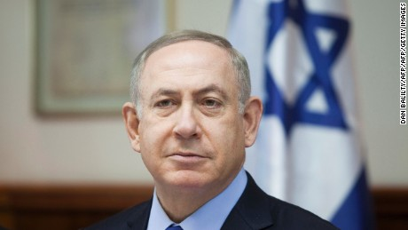 "Israeli Prime Minister Benjamin Netanyahu chairs the weekly cabinet meeting in Jerusalem on December 25, 2016. Israel was defiant over a UN vote demanding it halt settlements in Palestinian territory, after lashing out at US President Barack Obama over the ""shameful"" resolution. / AFP / AP AND POOL / Dan Balilty        (Photo credit should read DAN BALILTY/AFP/Getty Images)"