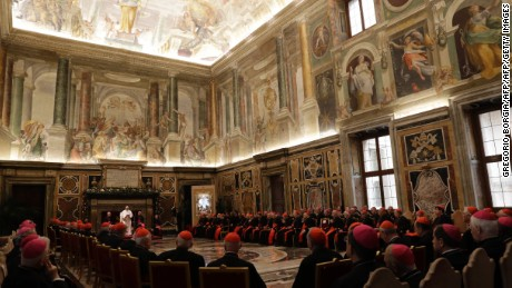 Pope Francis (L) speaks on the occasion of his Christmas greetings to the Roman Curia in the Clementine Hall, at the Vatican on December 22, 2016. / AFP / POOL / GREGORIO BORGIA        (Photo credit should read GREGORIO BORGIA/AFP/Getty Images)