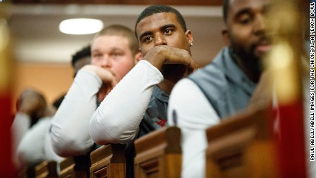 College football players from Alabama Crimson Tide and the Washington Huskies visit Historic Ebenezer Baptist Church on Tuesday night.