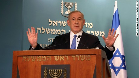 Israeli Prime Minister Benjamin Netanyahu gestures as he delivers a statement to the press at his Jerusalem office on December 28, 2016, in response to a speech by the US Secretary of State. / AFP / GALI TIBBON        (Photo credit should read GALI TIBBON/AFP/Getty Images)