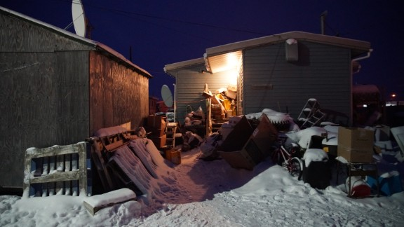 Most homes have no running water or sewage. Locals harvest ice from a nearby lake and melt it for drinking water.
